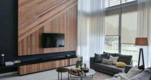 Wil's 11 Residence: Wohnzimmer mit einer doppelwandigen Holzwand mit